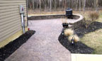 Masonry Landscaping Wall and Stamped Concrete Walkway